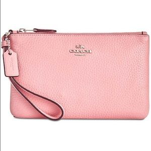 small pink coach wristlet